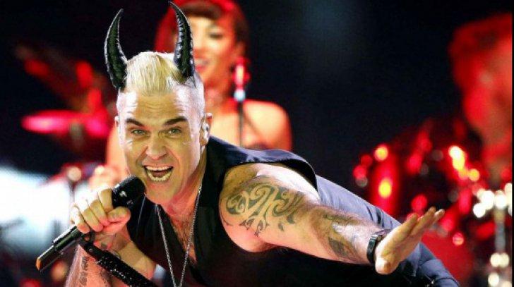 """""""Nu ştiam că-s atât de iubit aici,"""" le-a spus Robbie Williams fanilor, la Bucureşti"""