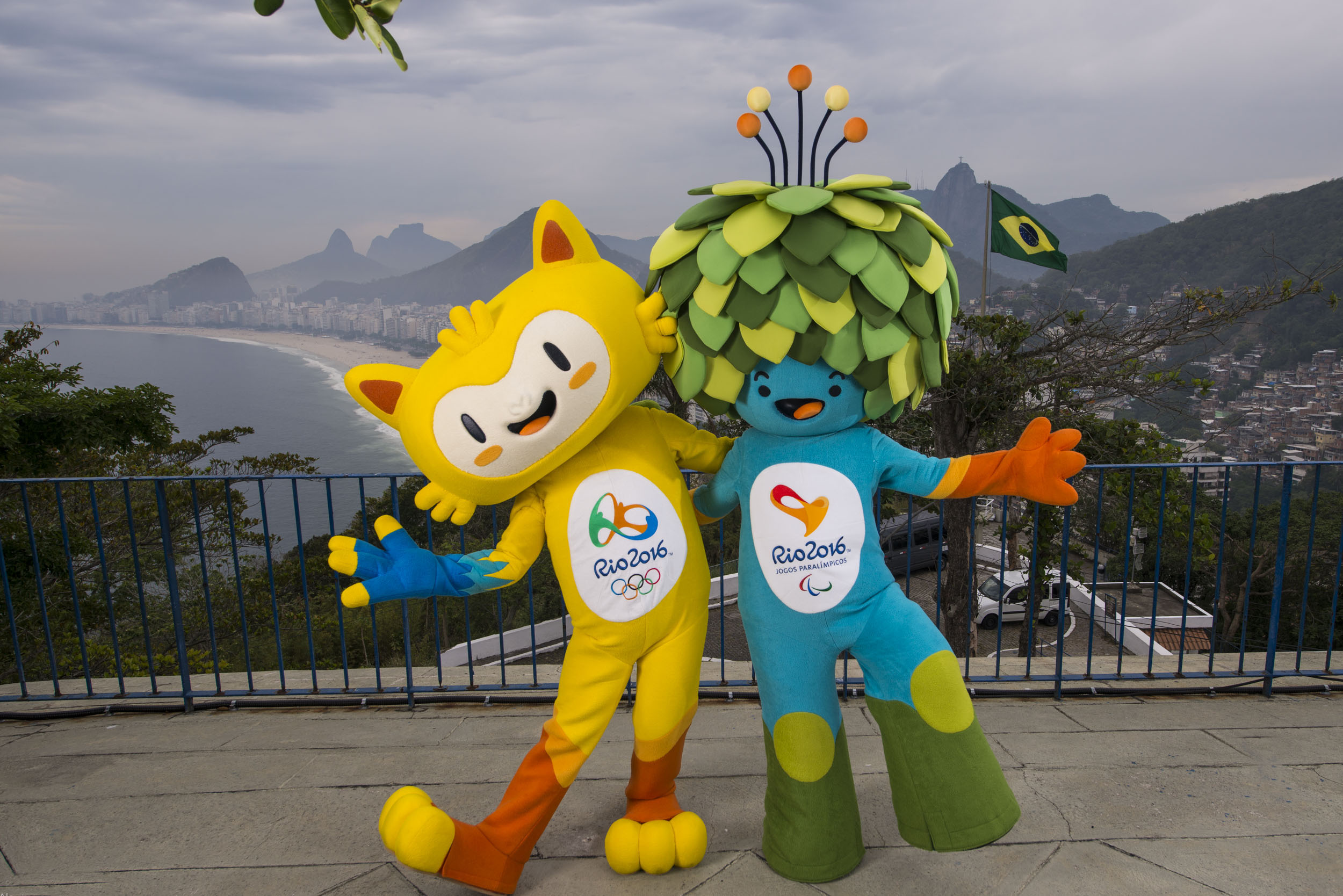 In this photo released by Rio 2016 Organizing Committee for the Olympic and Paralympic Games, the mascots of Rio 2016 Olympic, left, and Paralympic Games pose for a photo at the Leme Fort, with Copabana beach, left, in the background, in Rio de Janeiro, Brazil, Sunday, Nov. 23, 2014. The Mascots are inspired by the Brazilian fauna and flora. (AP Photo/Rio 2016, Alex Ferro)